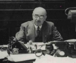 Samuel Stephany at his desk at New Court c.1933