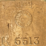 Detail of stamped identification marks on a gold bar from the Royal Mint Refinery bearing Rothschild stamps