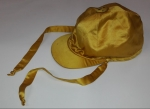 Jockey's cap in the distinctive Rothschild gold colour
