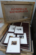Unpacking the framed images from their crates upon arrival at The Rothschild Archive